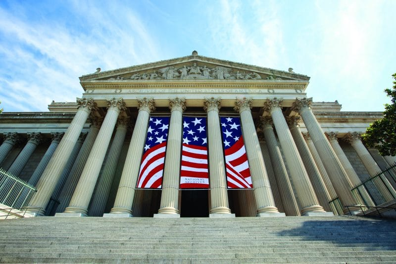 Fourth of July banneres hang from the Constitution Avenue side of the National Archives building in Washington, DC, on June 30, 2016, in preparation of the upcoming Fourth of July weekend.