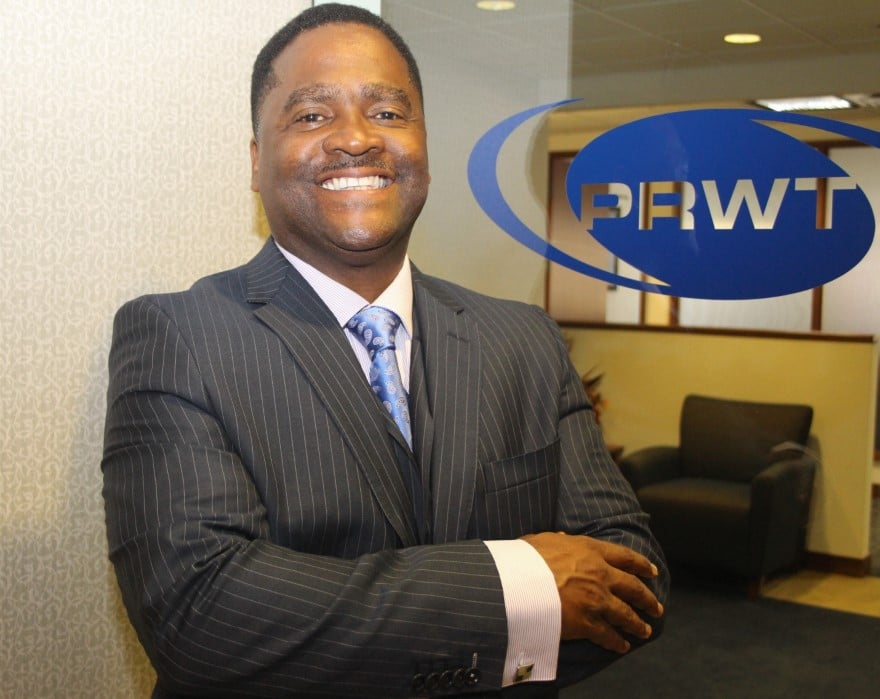 Malik Majeed — PRWT Services Inc. (parent) and U.S. Facilities (wholly owned subsidiary)